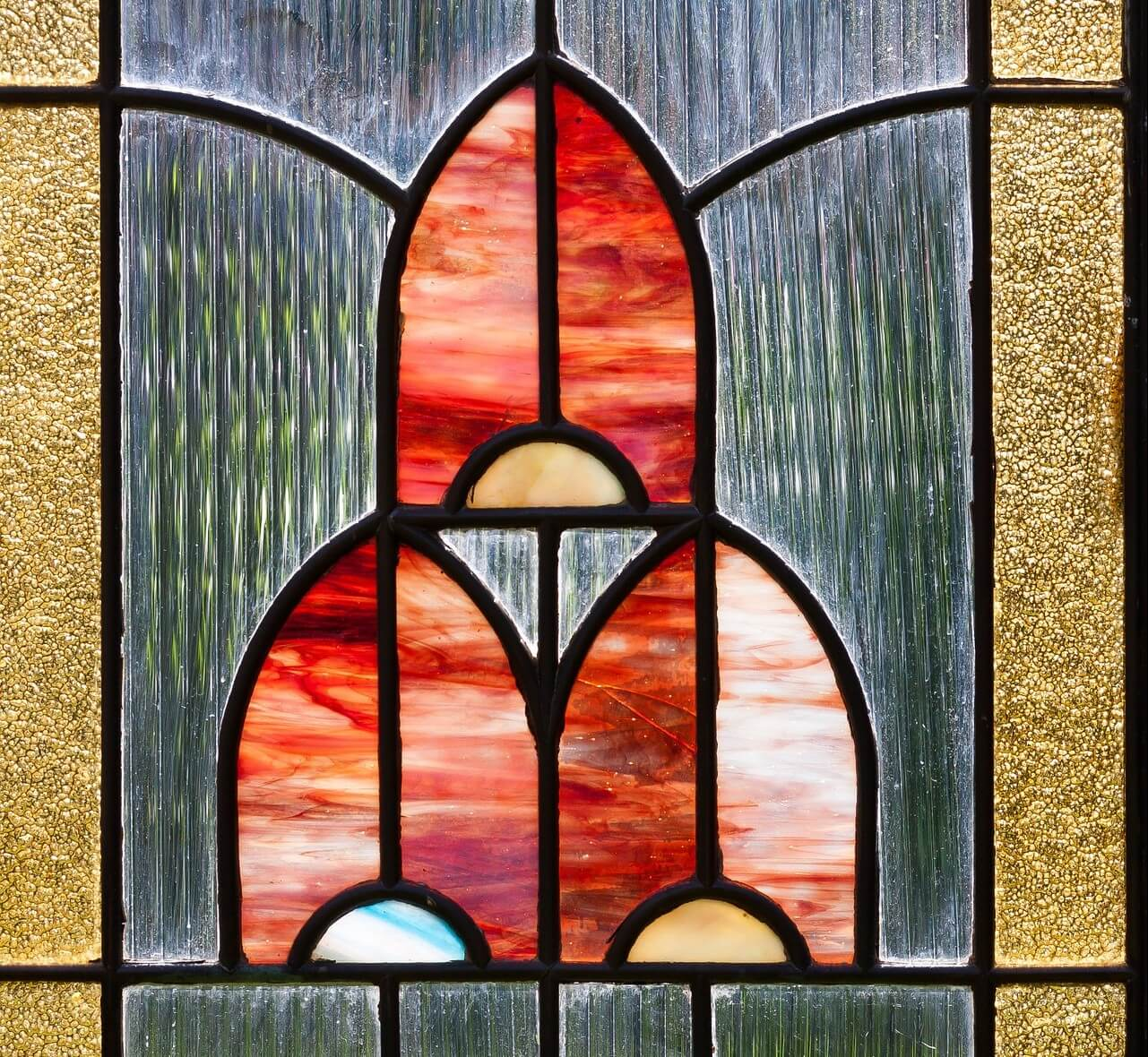 A photo of a stained glass front door window in the art nouveau style