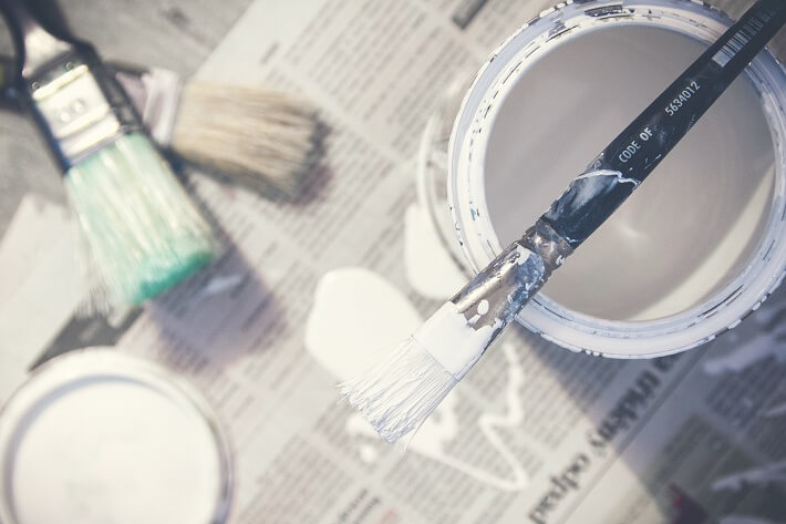 A paint pot and brushes