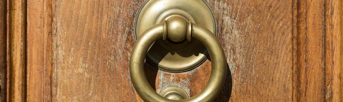 A worn door knocker