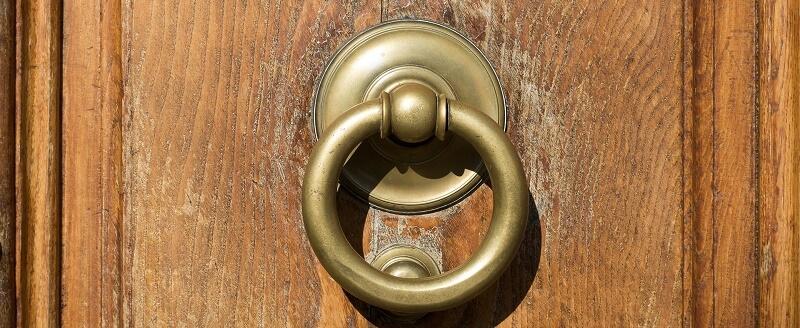 A worn door knocker