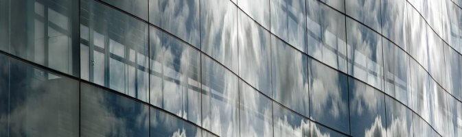 Windows reflecting the sky